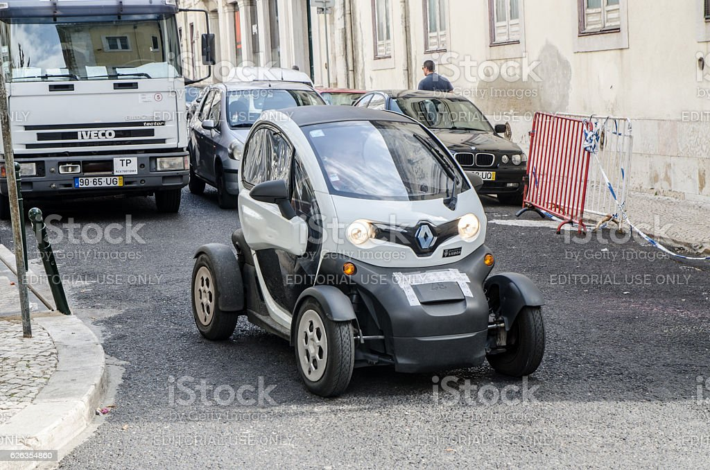 Renault Twizy passing in street stock photo