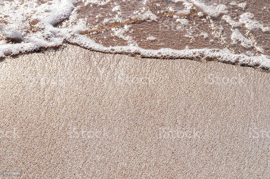 rencontre entre la mer et le sable stock photo