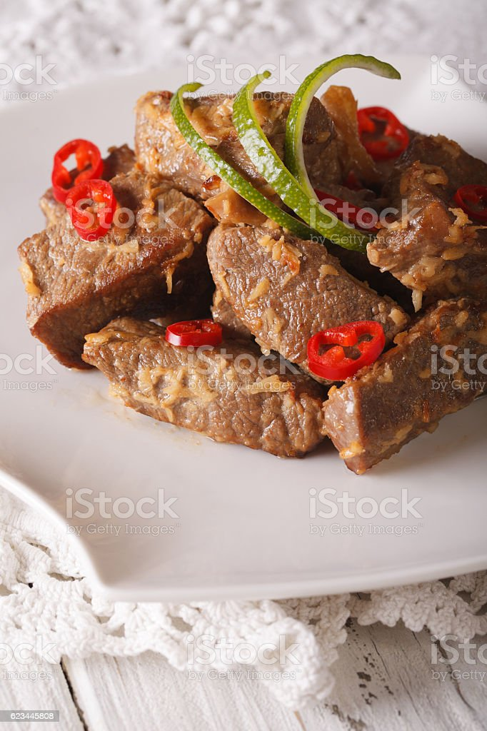 Rendang beef stewed in coconut milk with spices close-up stock photo