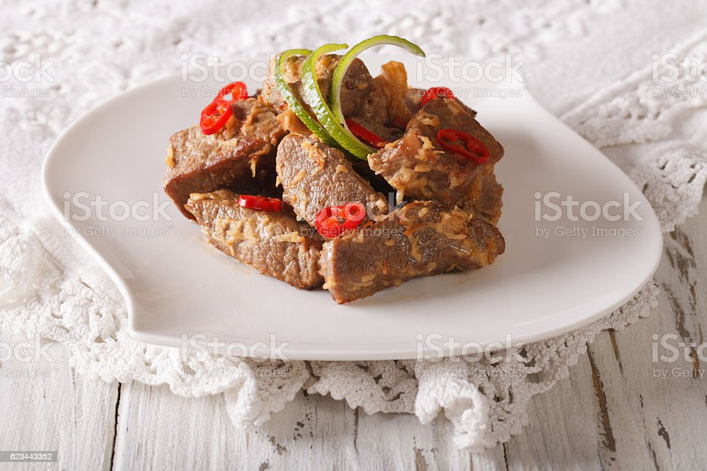 Rendang beef with spices close-up on the table. horizontal stock photo
