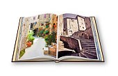 3D render of an opened photo book of Pitigliano Village