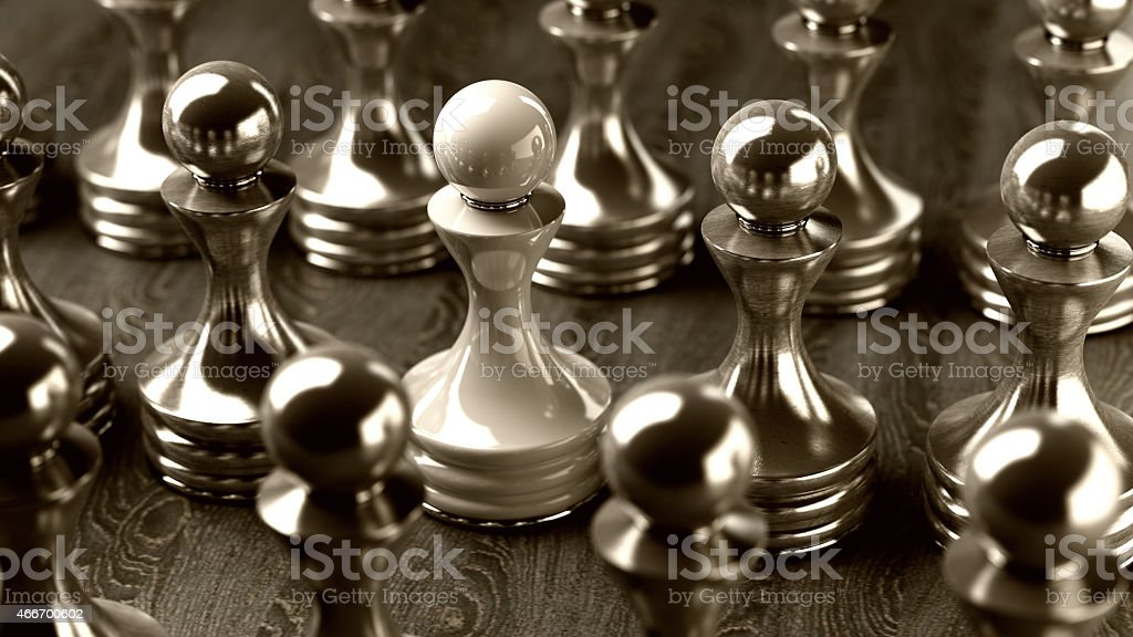 A 3D render of shiny chess pawns on a wooden surface stock photo