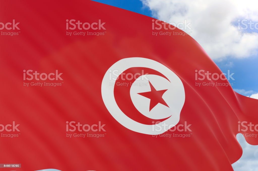 3D rendering of Tunisia flag waving on blue sky background stock photo