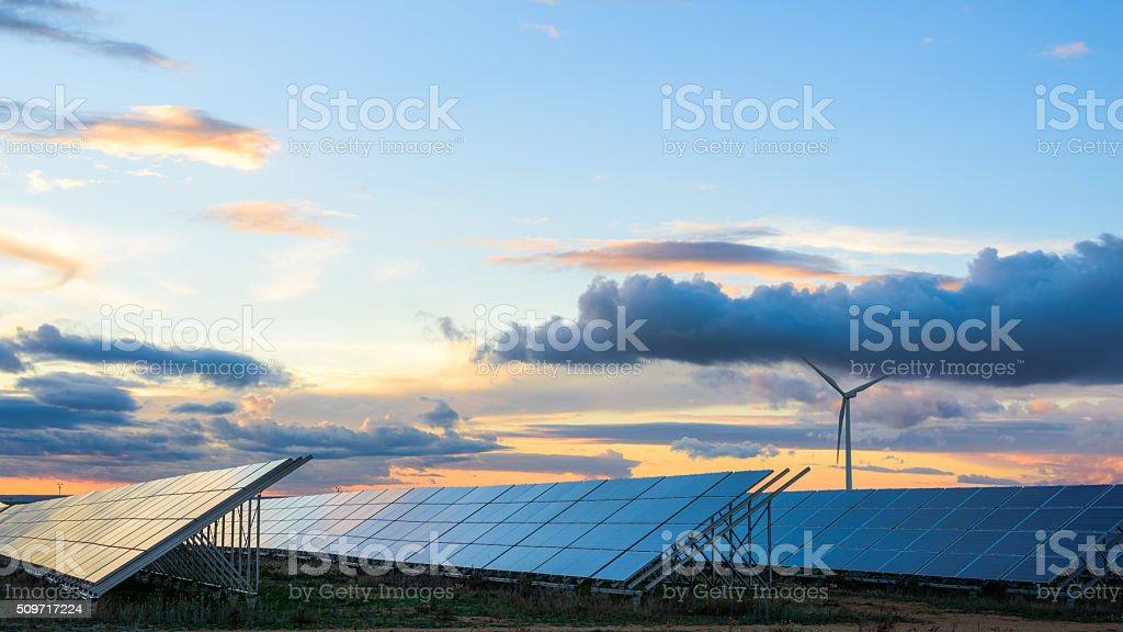 Renewable energies at sunset II stock photo