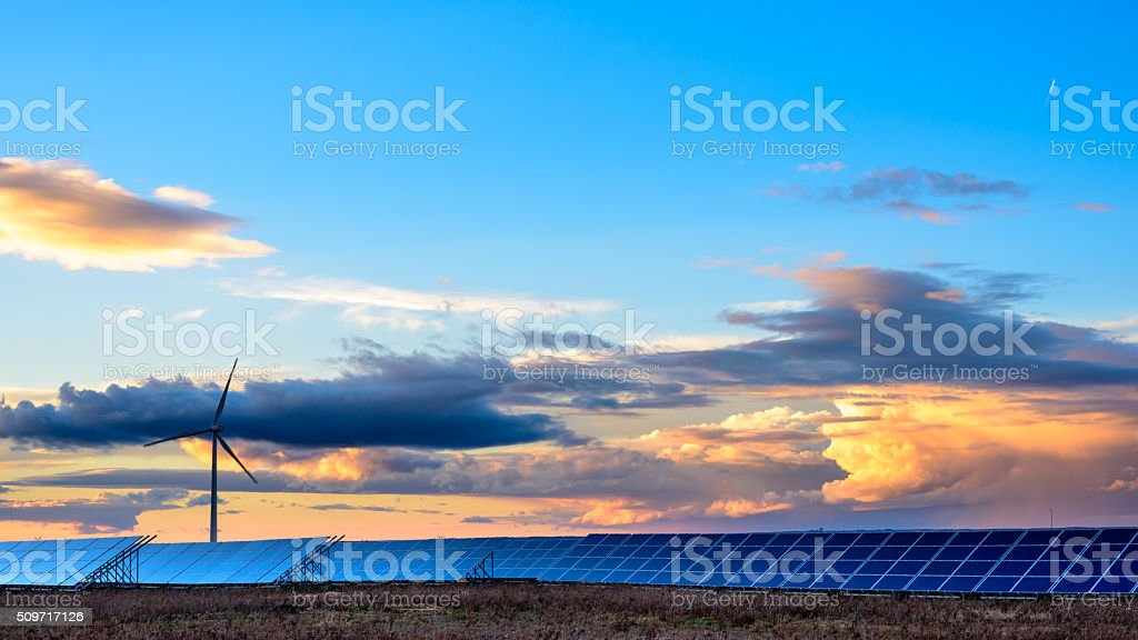 Renewable energies at sunset III stock photo