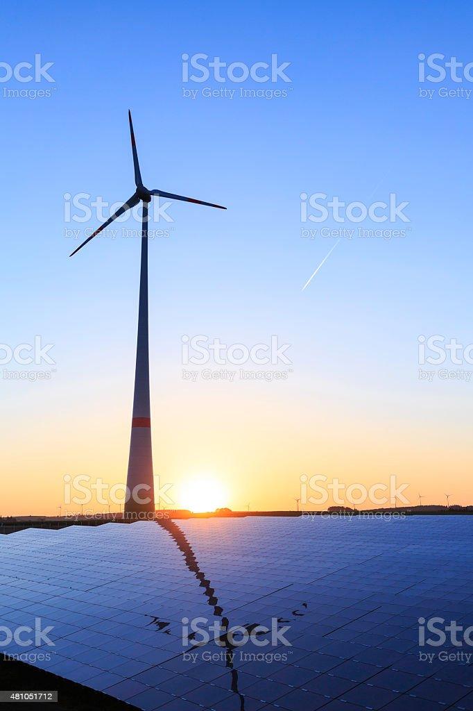 renewable energy: wind turbines and modern solar panels stock photo