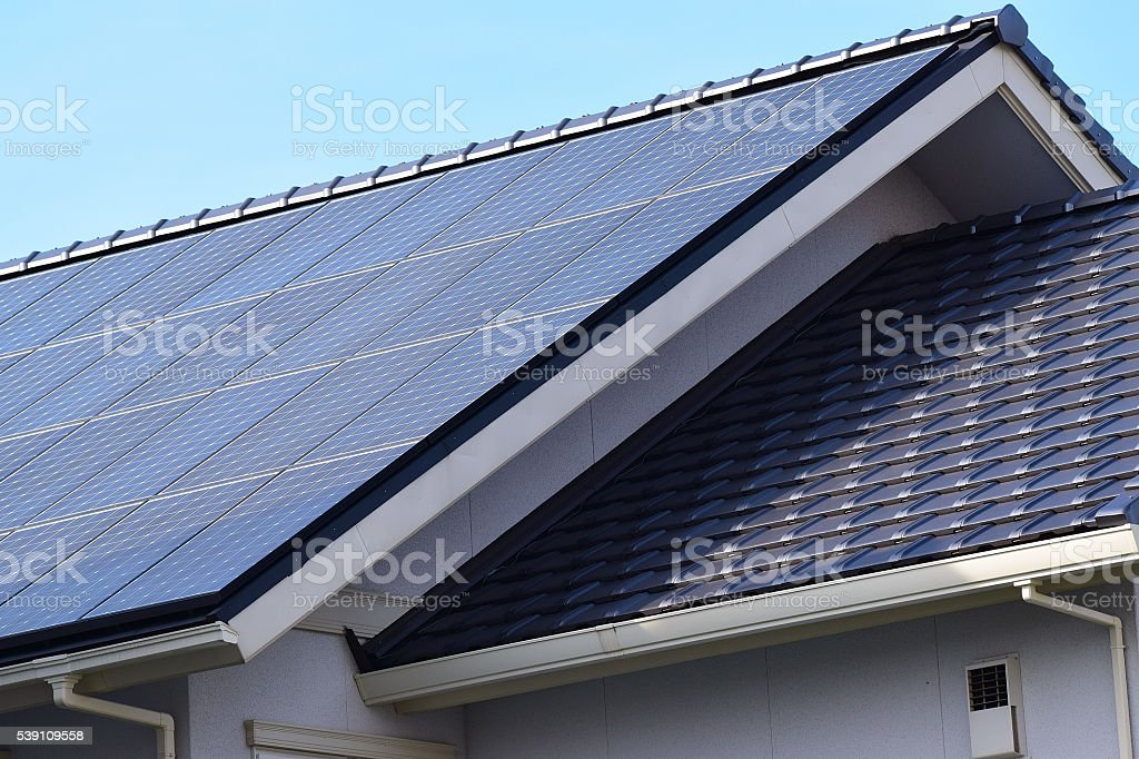 Renewable Green Energy Solar Panels on House Roof stock photo