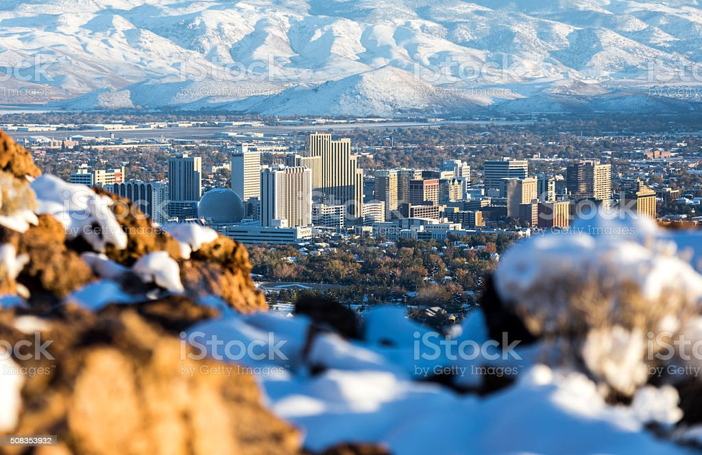 Reno, Nevada hidden behind some snow and rocks stock photo