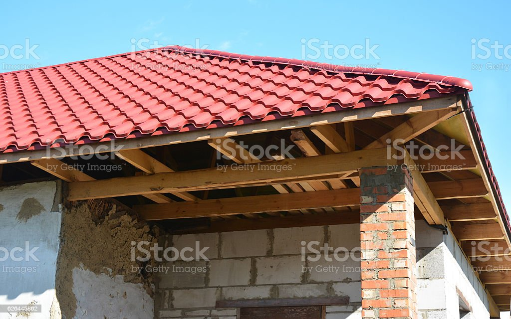 Renovation and repair of old house with roofing construction. stock photo
