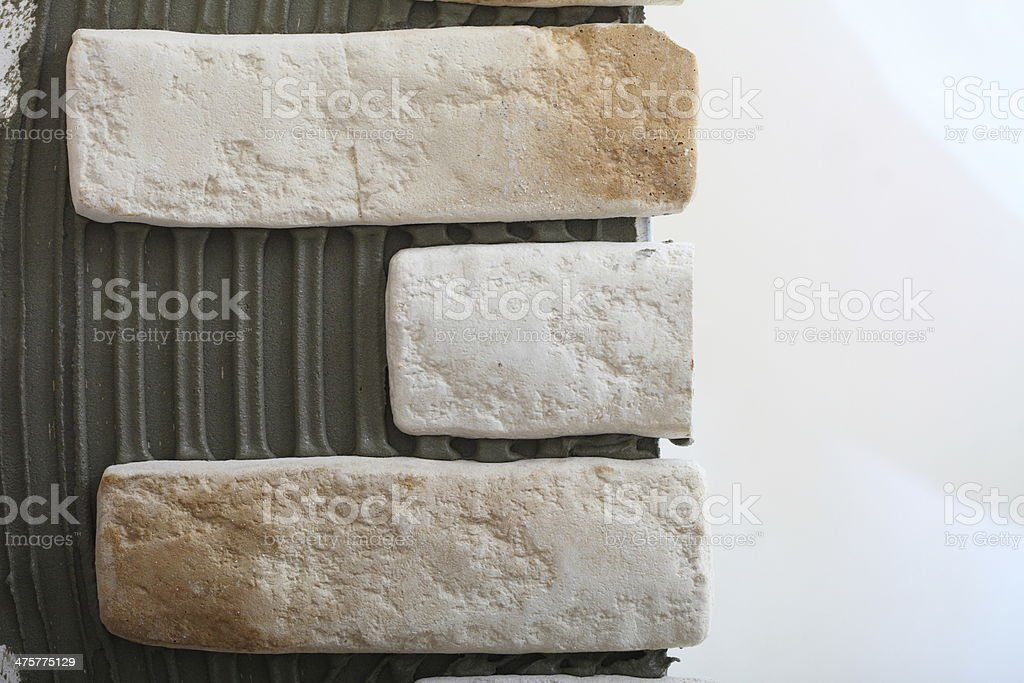 Renovation at home wall clinker tile glue royalty-free stock photo