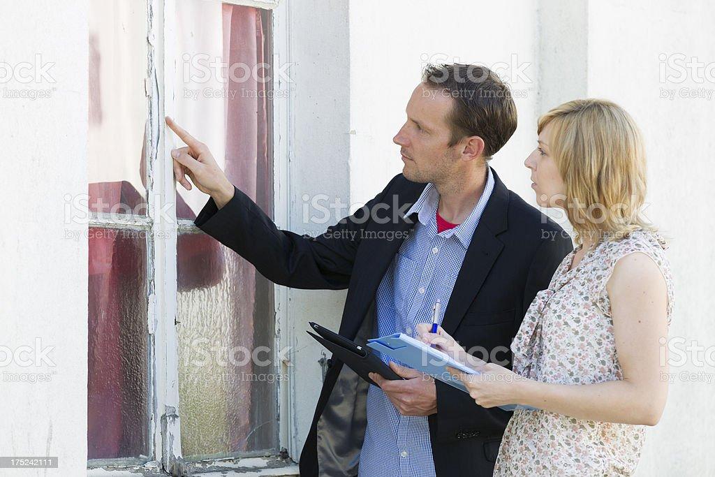 Renovation, looking at old window, examining stock photo