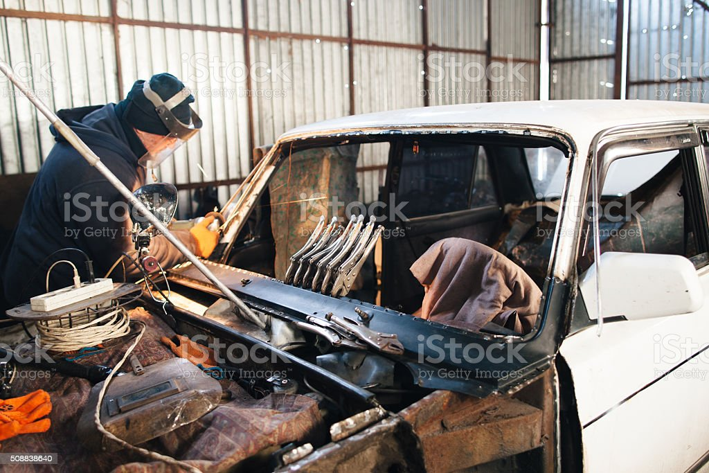 Renovation of old damaged car in Russia stock photo