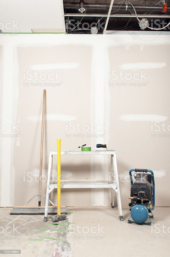 Renovation Tools Against and Unfinished Wall stock photo