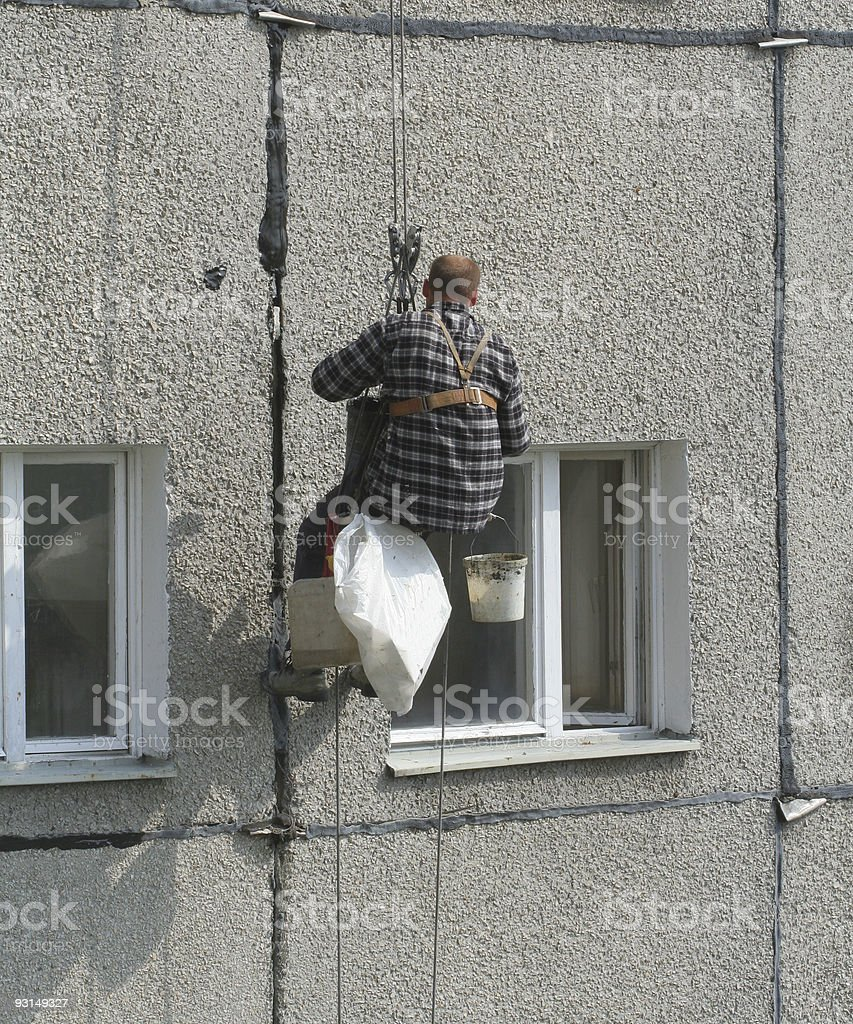 renovation worker on a block of flats #3 royalty-free stock photo