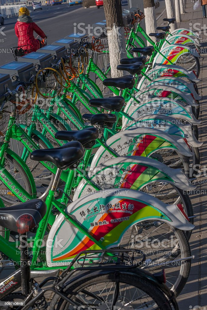 Rental bikes are parked on the street, Beijing stock photo