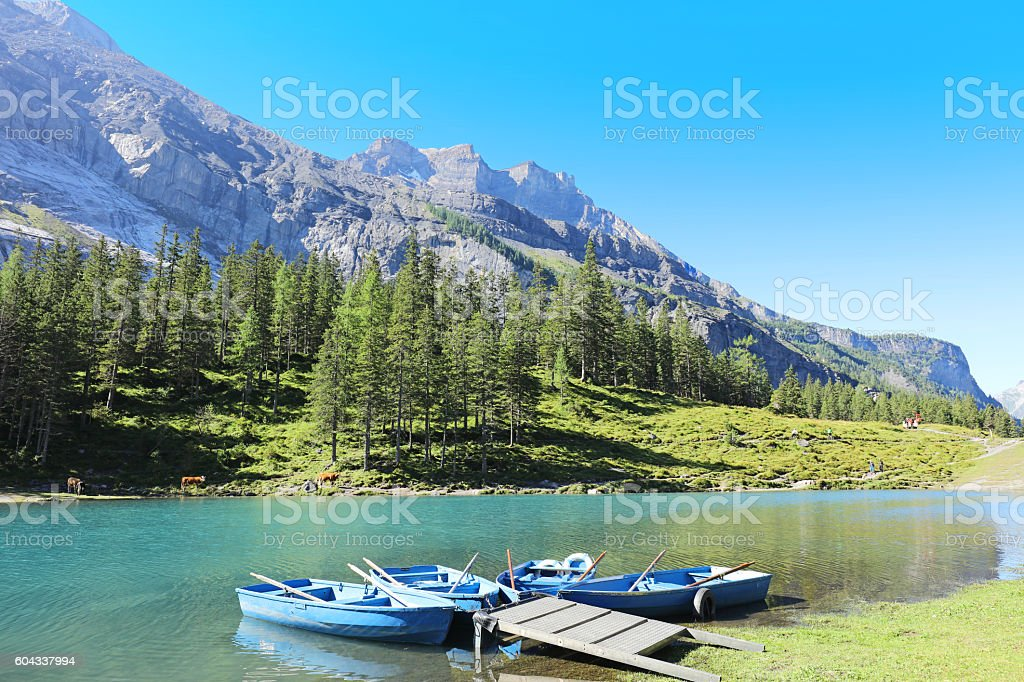 Rental Boats at Oeschinensee Lake in Switzerland stock photo