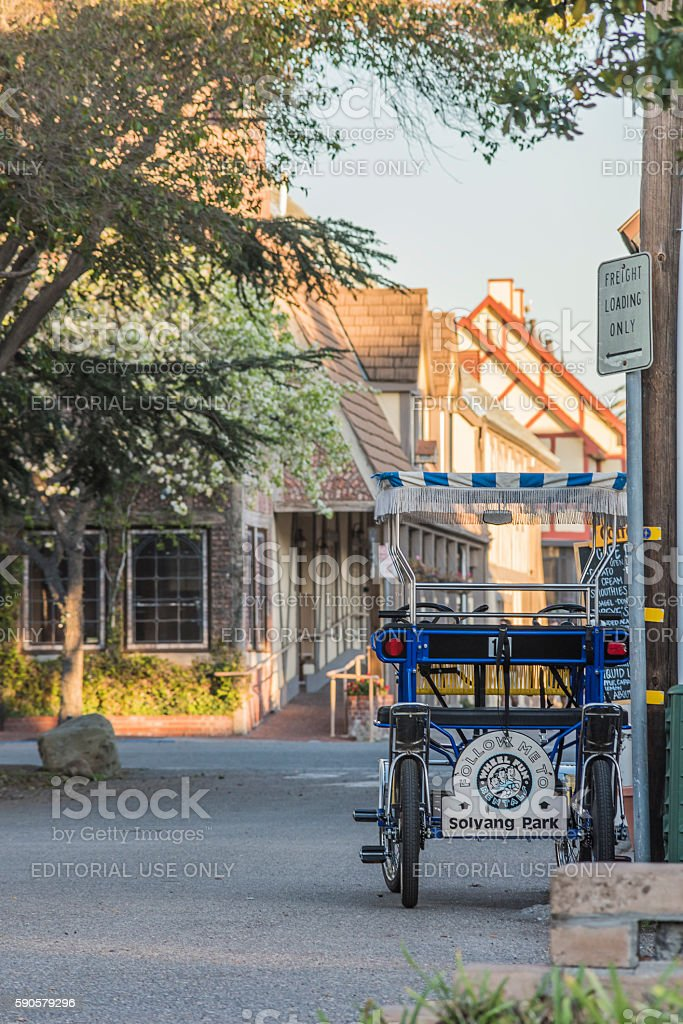 Rental surrey bike or trolley cart for carrying tourists Solvang stock photo