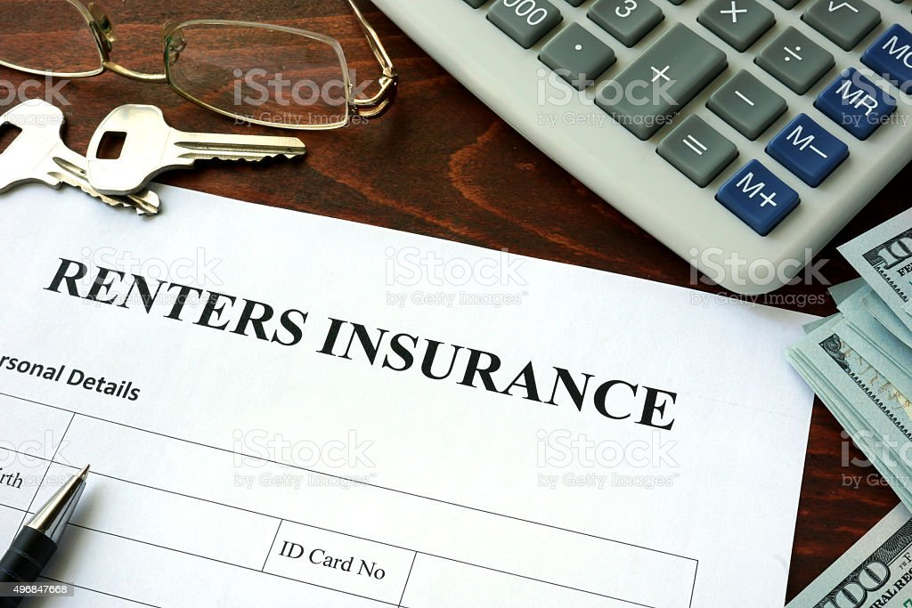Renters insurance  form and dollars on the table. stock photo