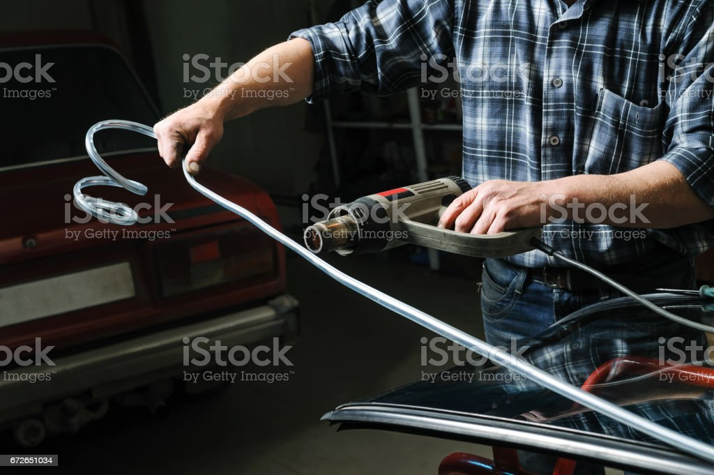 Repair and replacement of the windshield of the car. stock photo