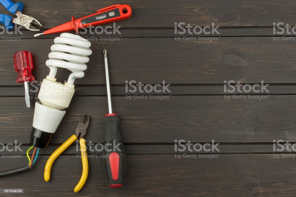 Repair broken lights. Energy saving light bulb stock photo