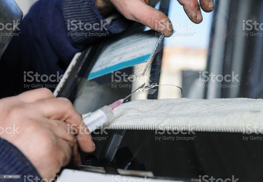 Repair cracked windshield. stock photo