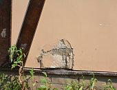 Repair Cracks and Holes in Stucco.