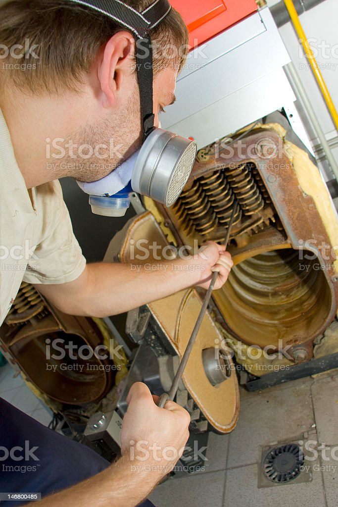 Repair man servicing big gas boiler royalty-free stock photo