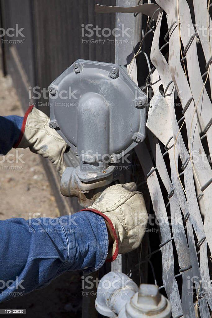 Repair Man's replacing Gas Meter royalty-free stock photo
