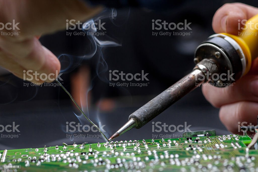 Repair of electronic devices, tin soldering parts stock photo