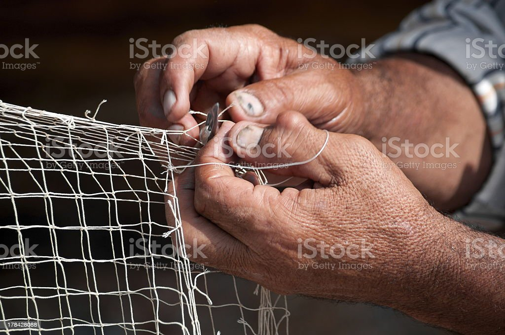 Repair of Fishing Net stock photo