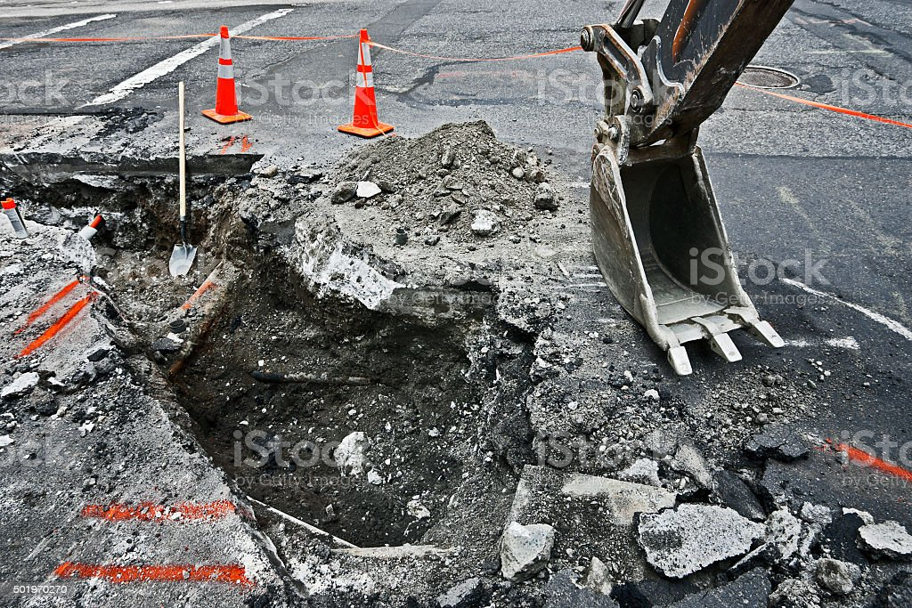repair of streets in urban areas of the city stock photo