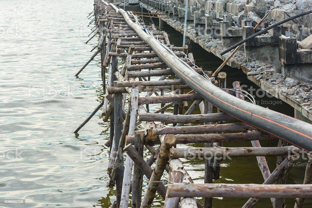 Repair old bridge in a sea stock photo