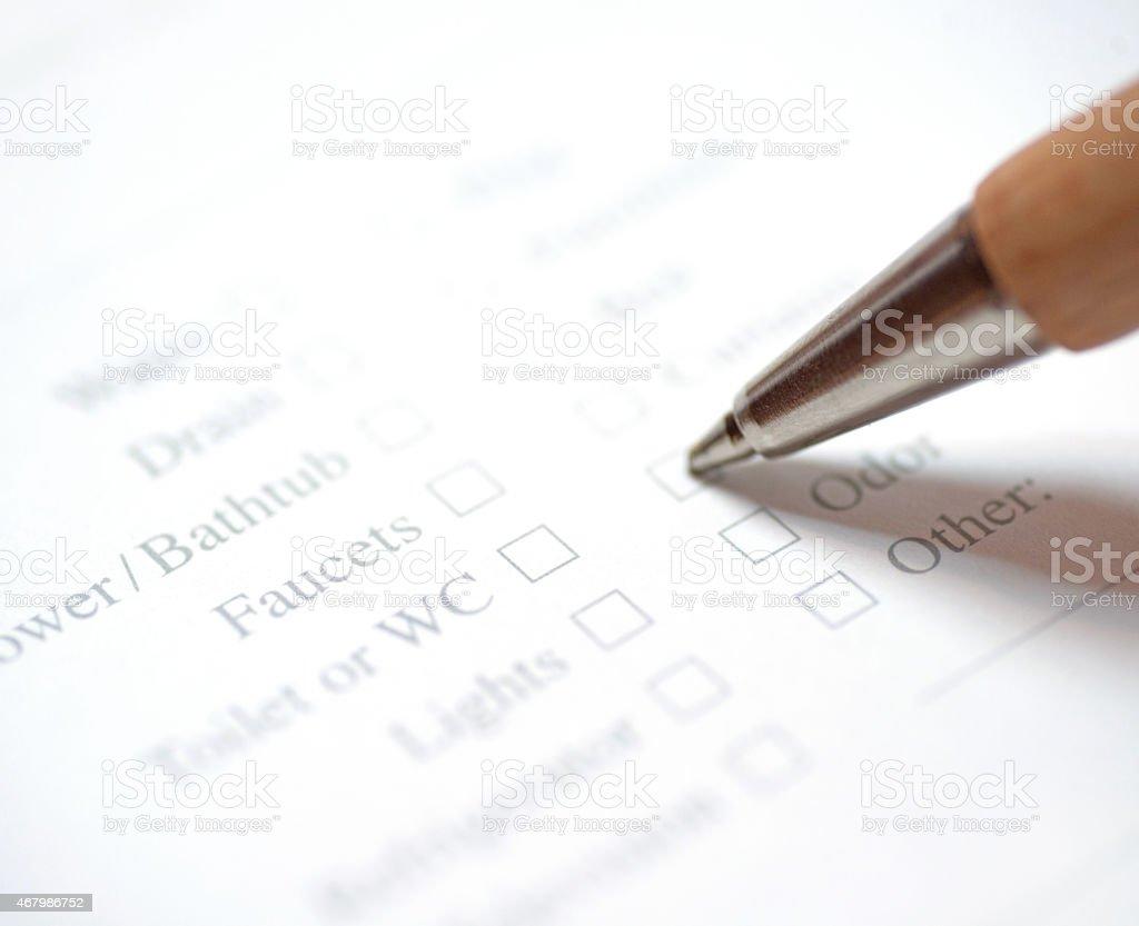 repair survey macro with pen stock photo
