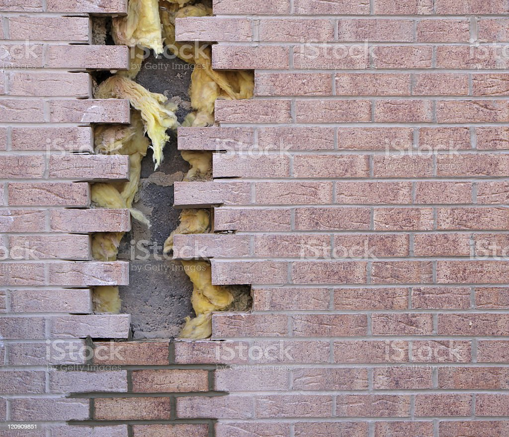 repaired bricked wall stock photo