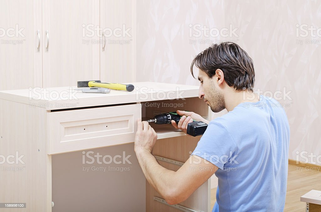 repairer in assembly of furniture stock photo