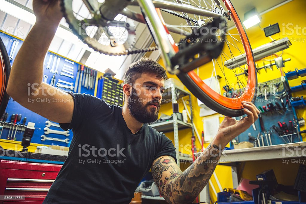 Repairing a bike stock photo