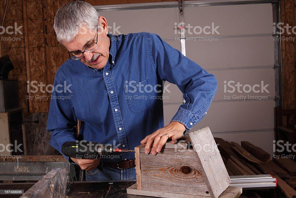 Repairing a Birdhouse royalty-free stock photo