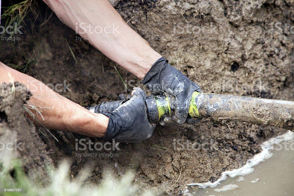Repairing a Broken Pipe stock photo