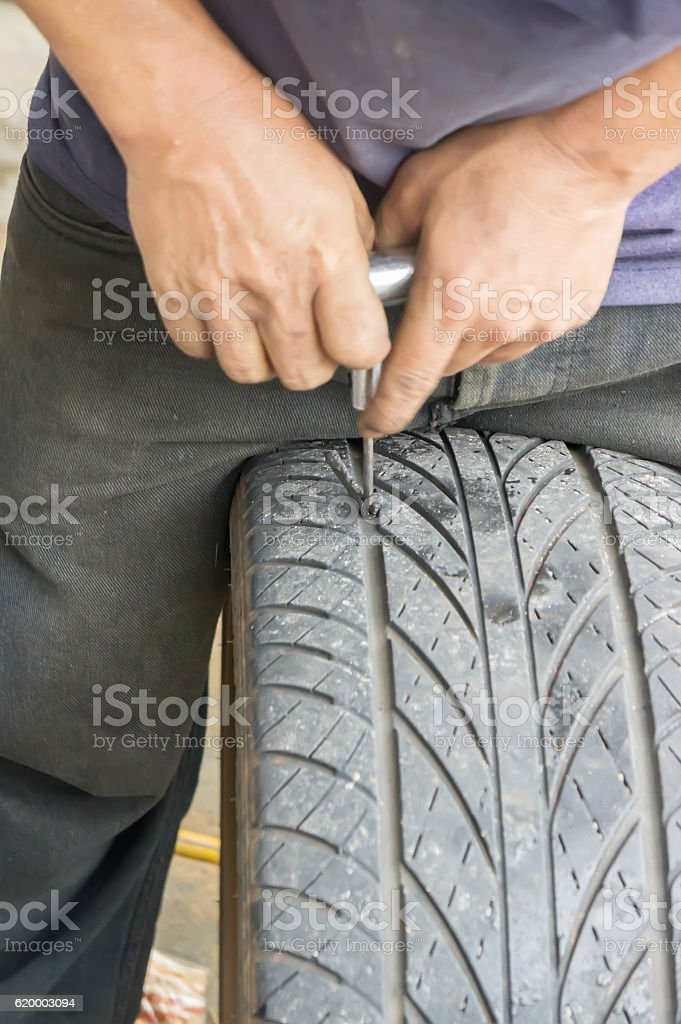 Repairing a leaky tire and a sealing tires stock photo