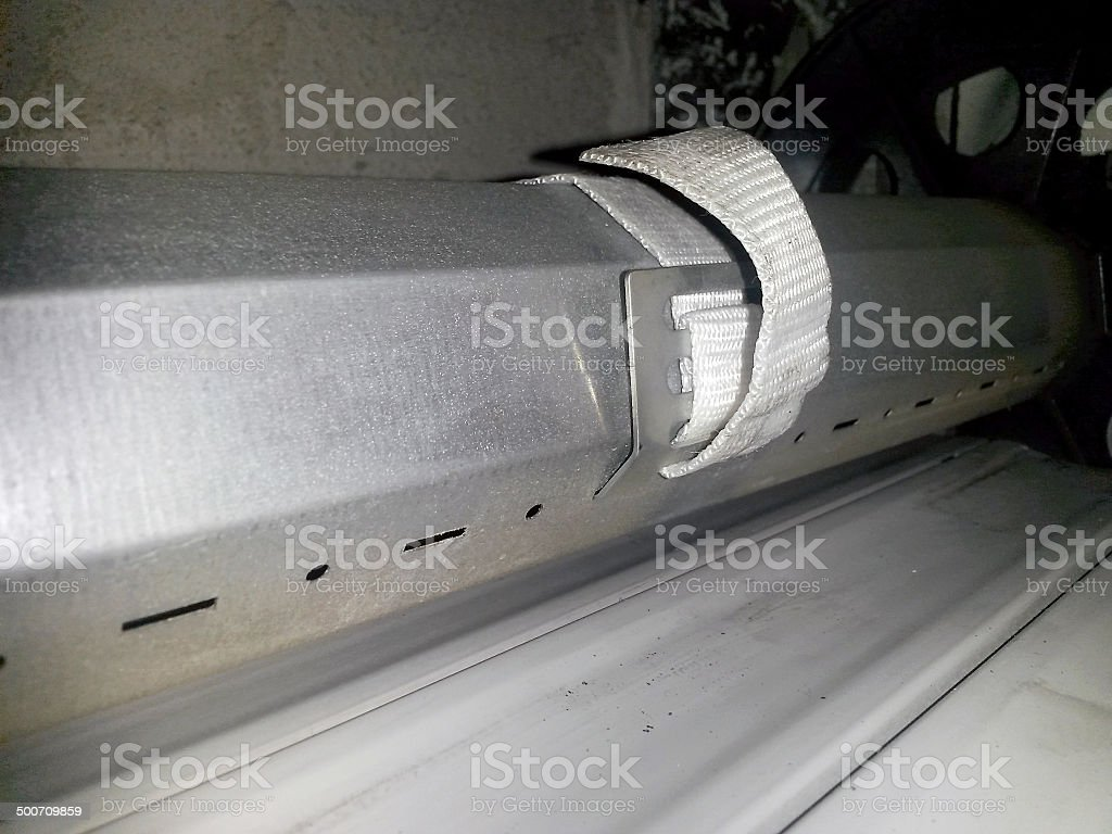 Repairing a roll-up shutter royalty-free stock photo