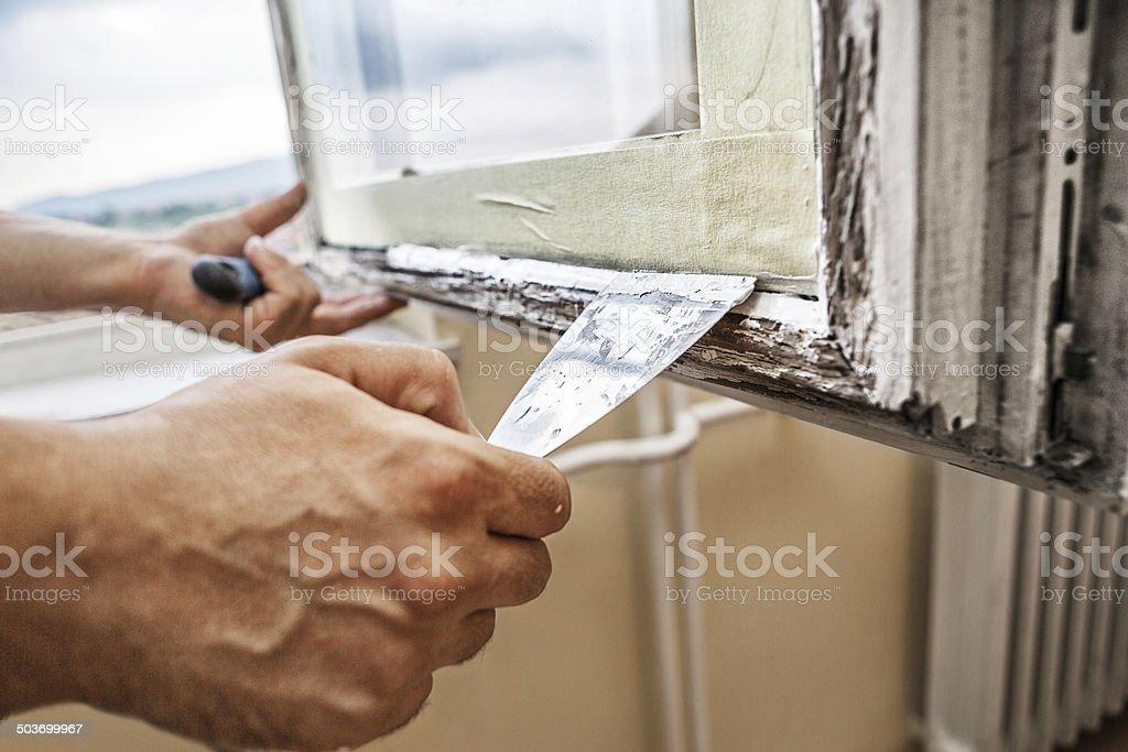 Repairing a window frame stock photo