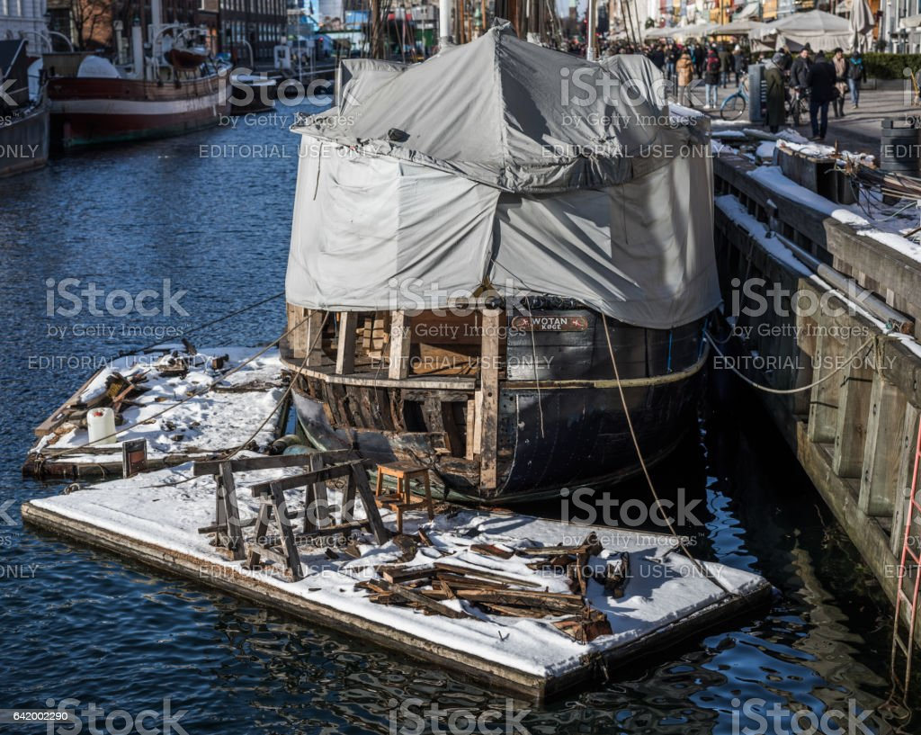 Repairing an old ship in Nyhavn, Copenhagen, Denmark stock photo