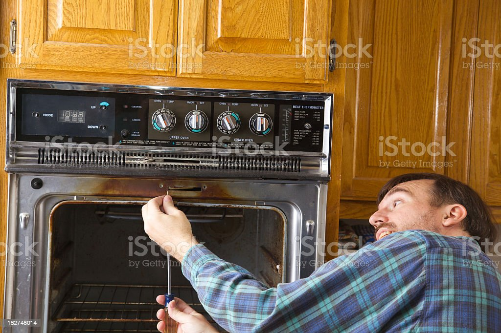Repairing an Oven royalty-free stock photo