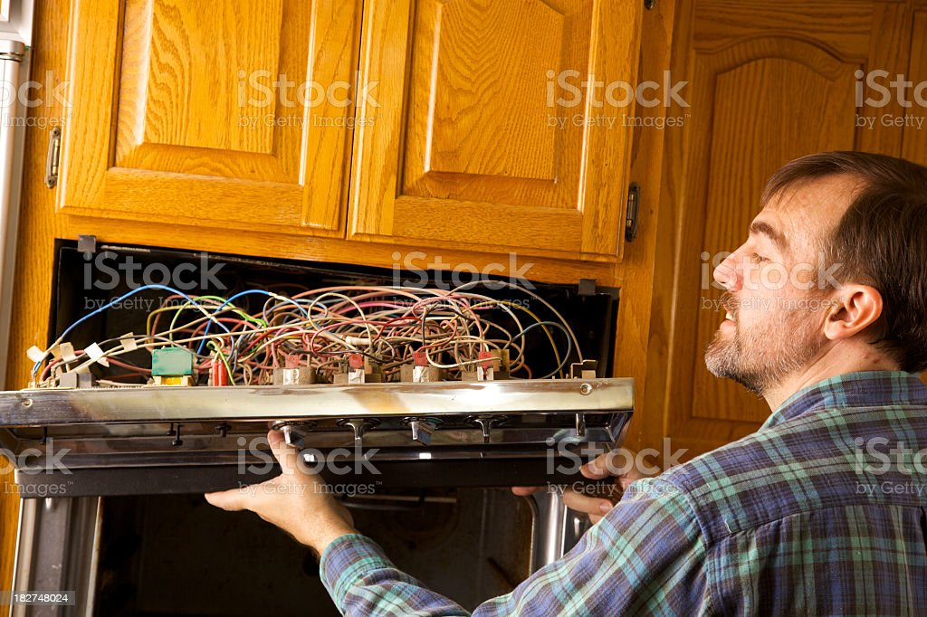 Repairing an Oven stock photo