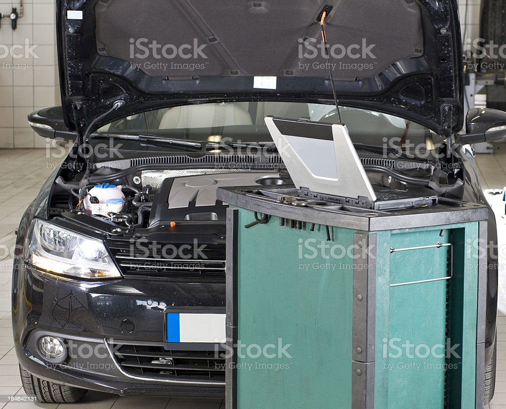 Repairing and checking car with Computer stock photo