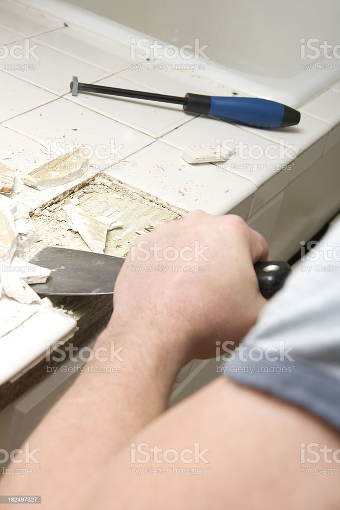 Repairing Broken Kitchen Tile stock photo