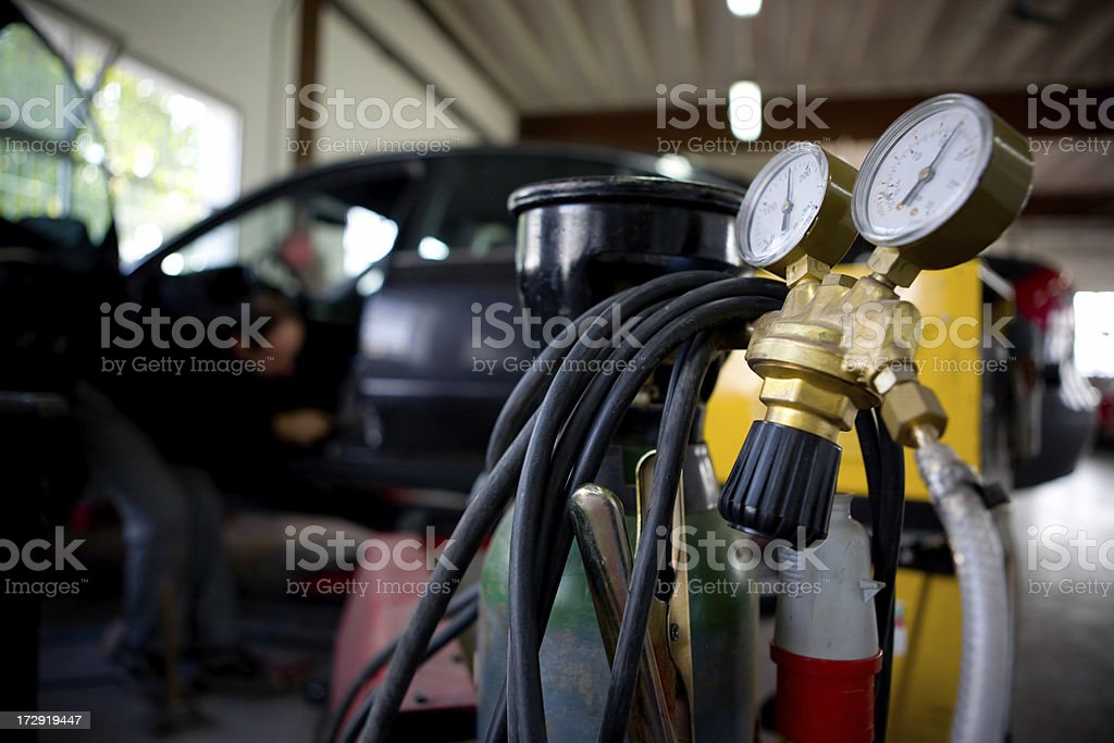 Repairing car and gas royalty-free stock photo