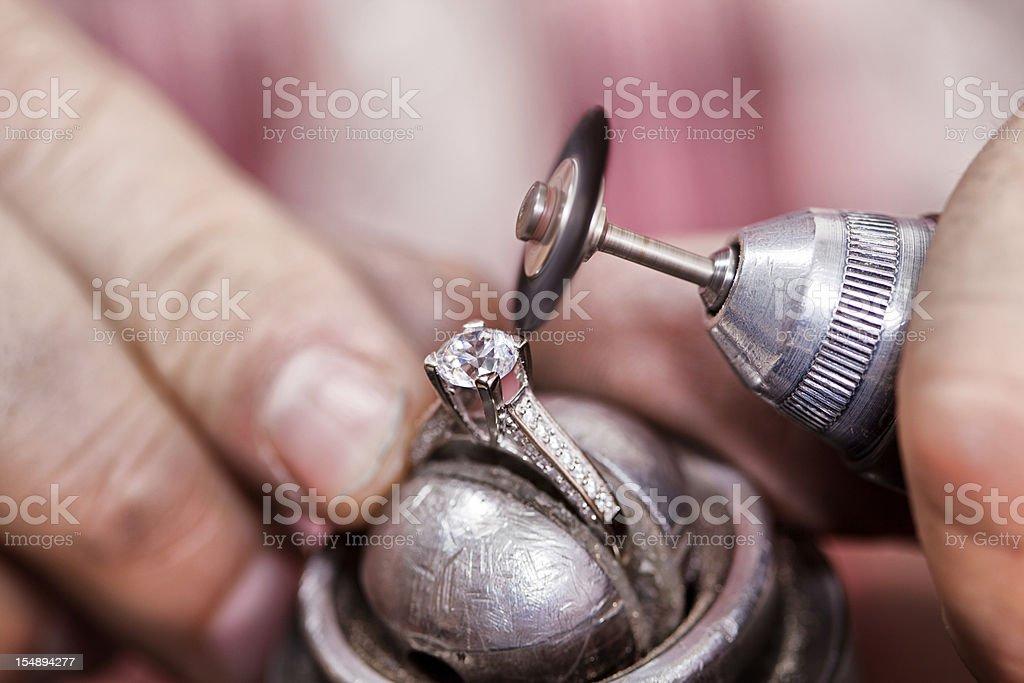 Repairing diamond ring stock photo