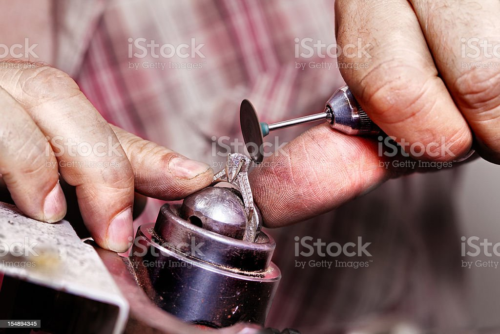 Repairing diamond ring stock photo