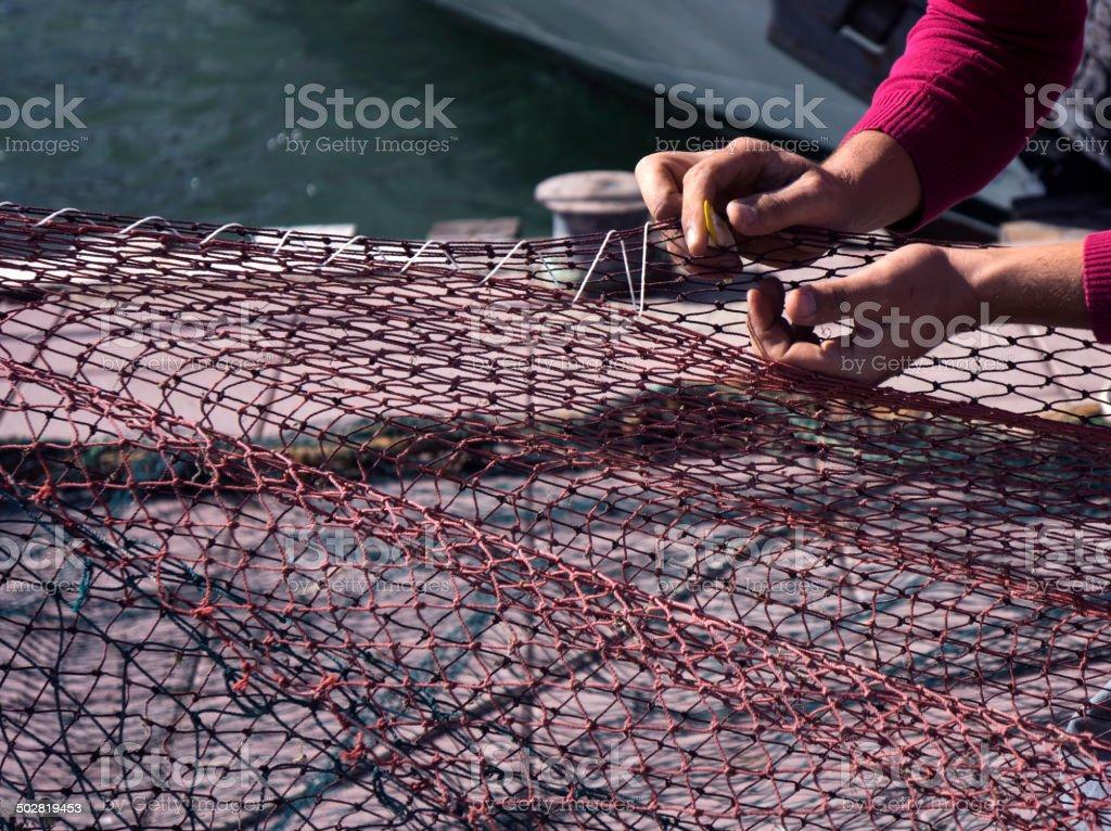 Repairing fishing net stock photo